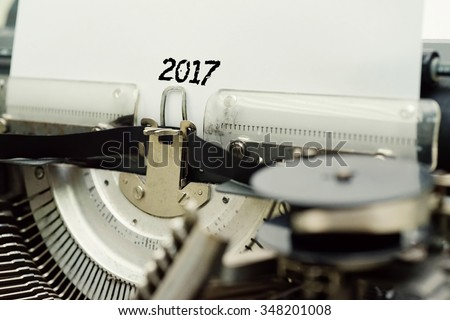 2017 - Paper Sheets in Old Vintage Typewriter . Business concept on Toned, Grain Effect, Shallow Depth Of Field and Blurred Background - stock photo