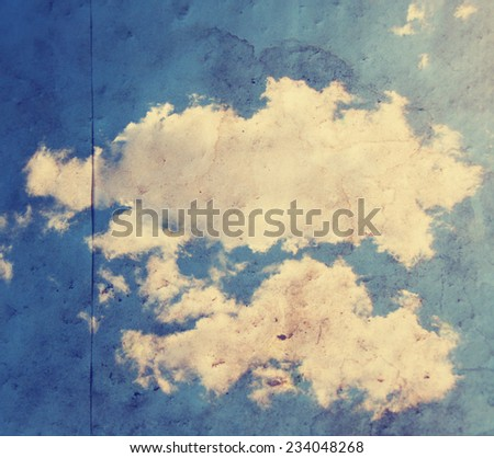 paper texture background with clouds toned with a retro vintage instagram filter  - stock photo