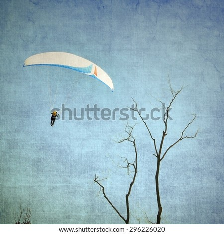 Paragliding in flight - stock photo
