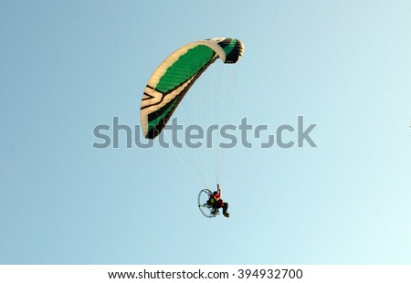 Paragliding in the blue sky. - stock photo
