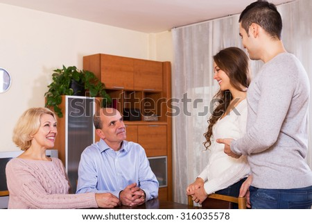 parents meeting girlfriend of their son  yestoday - stock photo