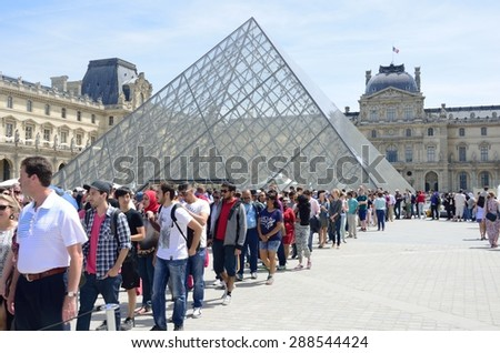 PARIS FRANCE 7 JUNE  2015: Large queue outside louvre Paris - stock photo