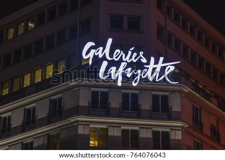 PARIS, FRANCE, on October 27, 2017. Letters of the name of the Gallery shop Lafayette in the downtown are illuminated by evening lighting