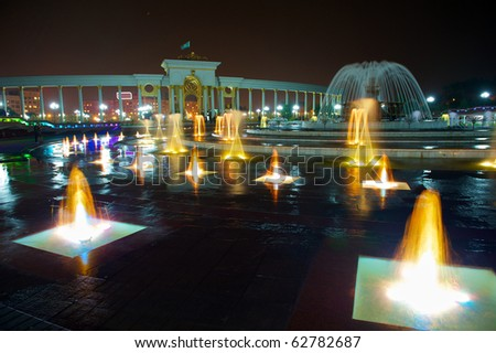 """Park of the first president of Republic Kazakhstan"" show with fountains, the picture is taken at the night"