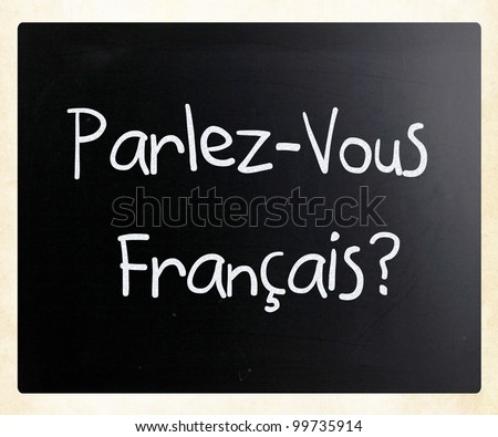 """Parlez-vous français?"" handwritten with white chalk on a blackboard - stock photo"