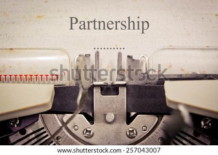 """Partnership"" written on an old typewriter"