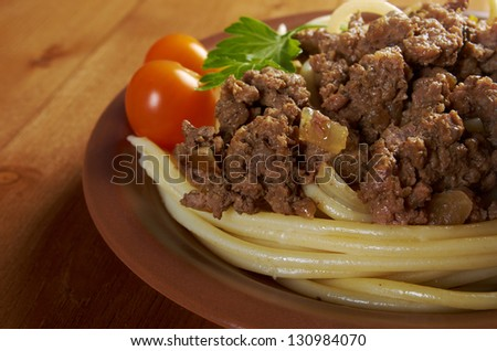 pasta with  beef on wooden table