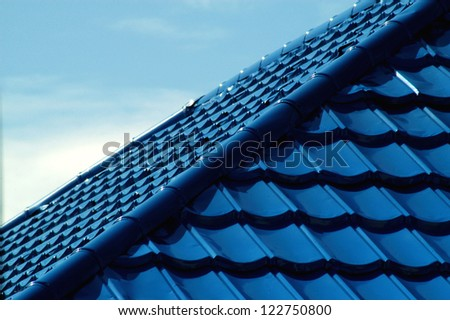 pattern of blue roof tiles - stock photo
