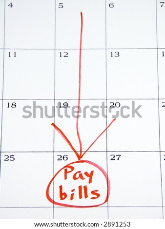 """Pay bills"" circled in red on white monthly calendar - stock photo"