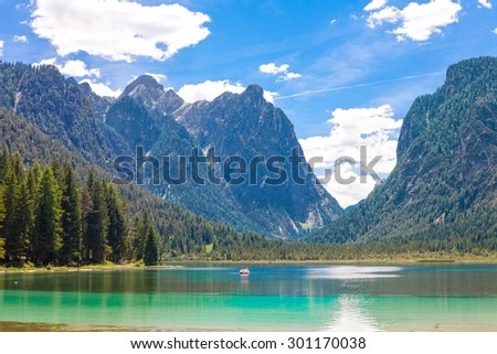 Pedal boat on Lake dobbiaco, in Dolomites mountain, Italy, Sudtirol