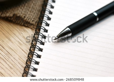 Pen, notebook, mobile phone, tablet - stock photo