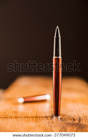 pen on black background.Creative ideas for advertising