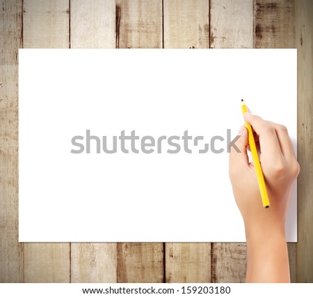 pencil in the hand  rubber writting something  - stock photo