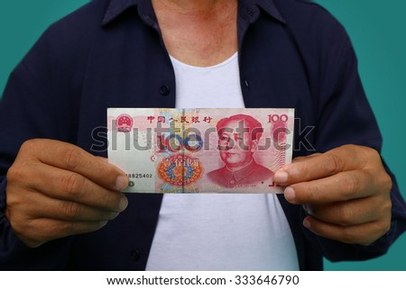 people, business, finances and money concept - close up of businessman hands holding open wallet with China money cash (RMB) - stock photo