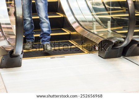 people in motion in a shopping mall - stock photo