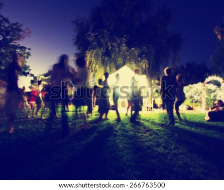 people mingling at a free concert by local musicians toned with a retro vintage instagram filter effect app or action  - stock photo