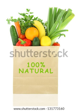 100 Percent Natural on a grocery bag full of vegetables and fruits - stock photo