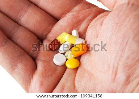 Person's Hand Holding Different Pills - stock photo