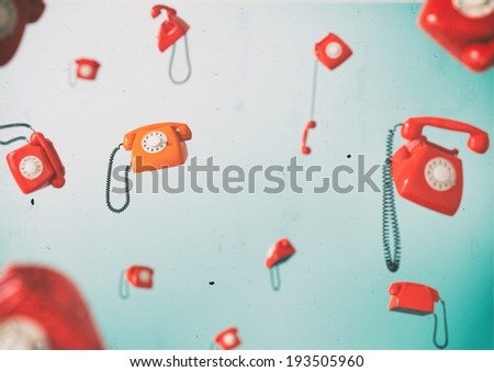 Phones flying in weightlessness. Vintage telephones.  - stock photo