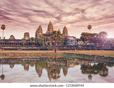 photo Angkor Wat sunset - ancient Khmer temple in Cambodia. UNESCO world heritage site - stock photo