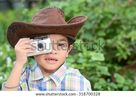 photo of the Kid with Photo camera outdoor - stock photo