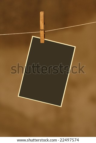 photo on metal rope with wood clothespins - stock photo