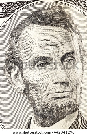 photographed close-up American dollars, small depth of field, banknote worth five dollars - stock photo