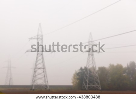 photographed close-up, high-voltage electric poles, out of focus