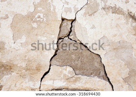 photographed close-up of a crack in the plaster walls of the old building. - stock photo