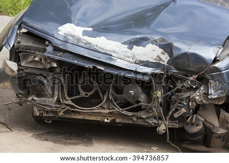 photographed close-up of the car after the accident on the road.