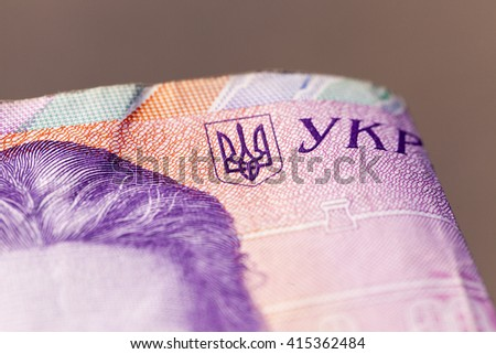 photographed close-up of two hundred Ukrainian hryvnia, small depth of field - stock photo