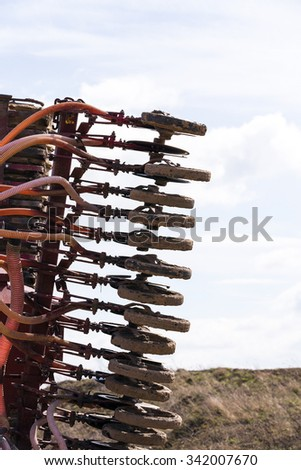 photographed close-up on the tractor wheels, intended for planting cereals - stock photo