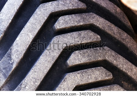 photographed close-up wheels of the tractor. dirty wheels - stock photo