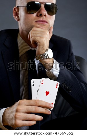 picture of a businessman holding a poker hand - pair of aces