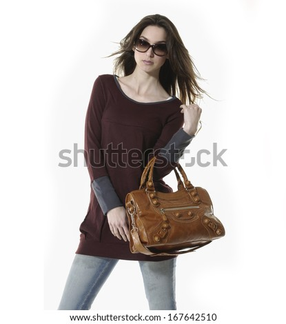 picture of young woman in blue jeans holding bag - stock photo