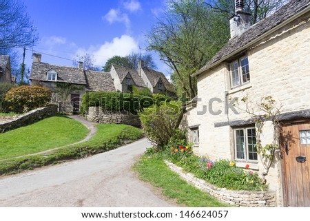 Picturesque, historic cottages in the Cotswolds tourist destination of Bibury,, Gloucestershire, UK.