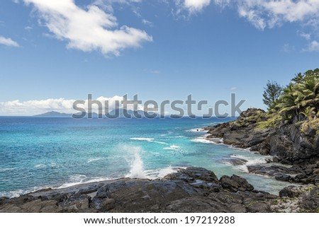 Picturesque volcanic rock formations along shoreline of Silhouette island,  Seychelles - stock photo