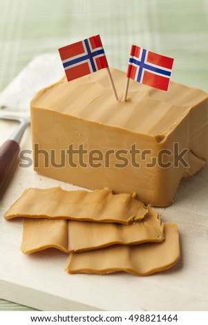 Piece and slices of norwegian flotemysost cheese