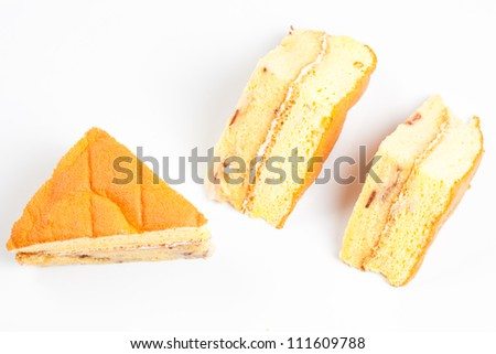 3 piece of yellow cake on a white background top view - stock photo