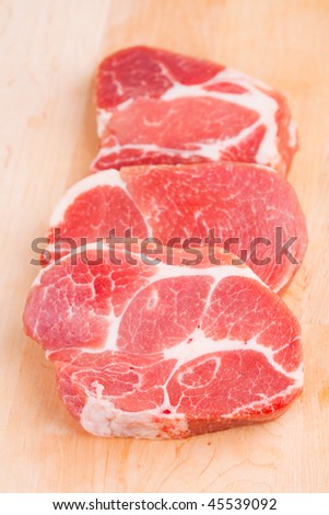 Pieces of the crude cooled meat lie on chopping board