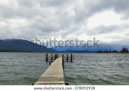 Pier within lake Te Anau in New Zealand, the largest lake in the South Island - stock photo