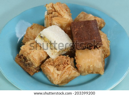 pile of assorted sweet baklava on a blue plate