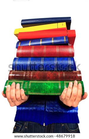 pile of books in closeup   in the hands of a woman - stock photo