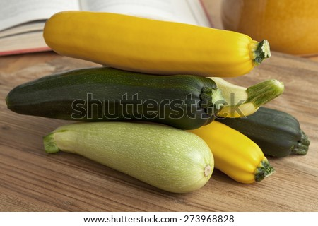 Pile of fresh raw courgettes in different colors - stock photo
