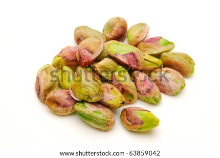 pile of pistachio nuts on white background