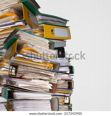 piles of file binder with documents on white paper background - stock photo