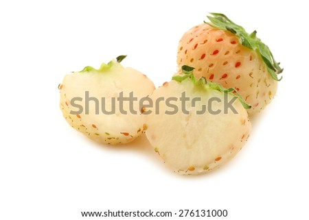 pineapple strawberry and a cut one on a white background - stock photo