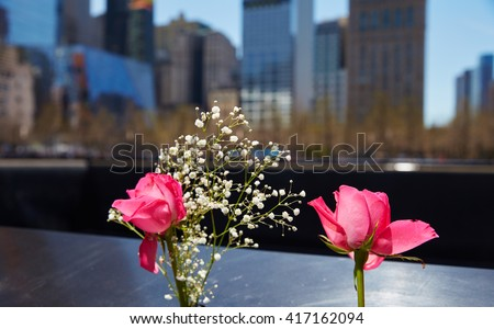 pink flower and baby's breath at 911 memorial world trade center - stock photo