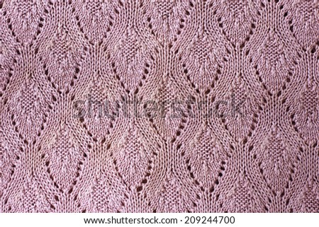 pink knitted fabric texture, warm dense knitted fabric. - stock photo