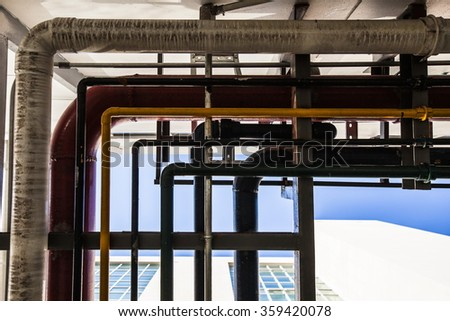 pipeline extinguishing water in industrial building - stock photo